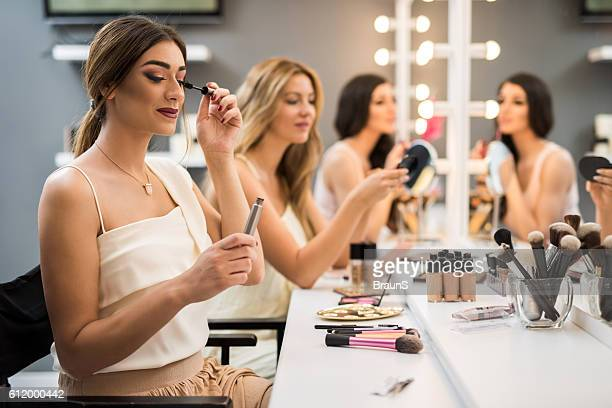 Young women having beauty treatment in make-up studio.