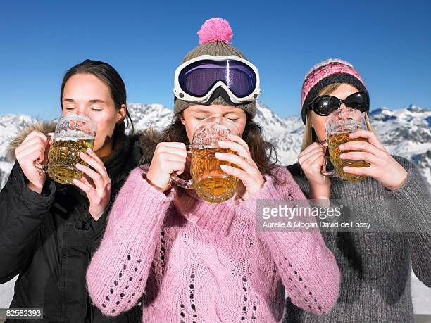 Young women having drink at mountains