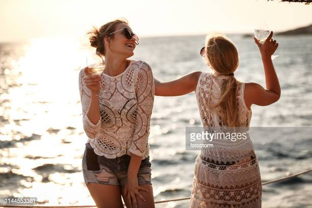 young women having fun at the beach - mediterranean sea stock pictures, royalty-free photos & images