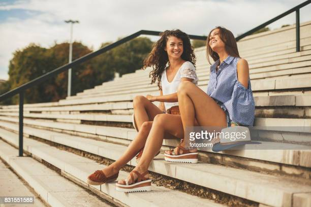 young women having nice time together - open toe stock pictures, royalty-free photos & images