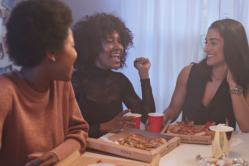 Young women having party in the kitchen and eating pizza - gettyimageskorea