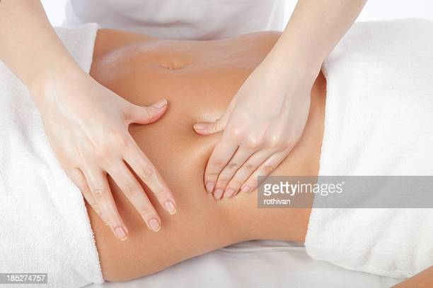 young women having stomach massage - massage therapist stock pictures, royalty-free photos & images