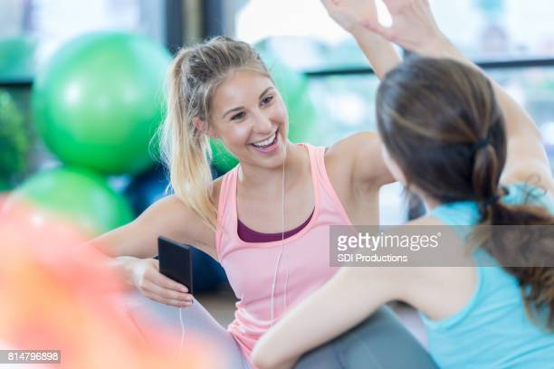 Young women high five after a great workout