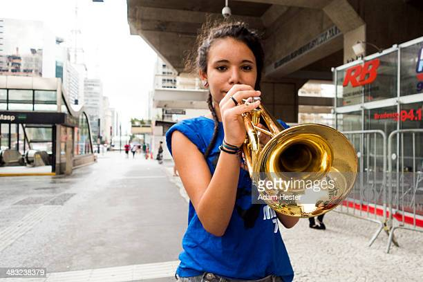 A young women holding a musical instrument.