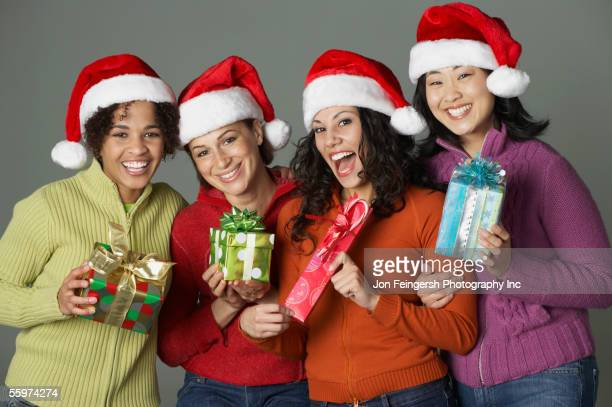 Young women holding holiday gifts