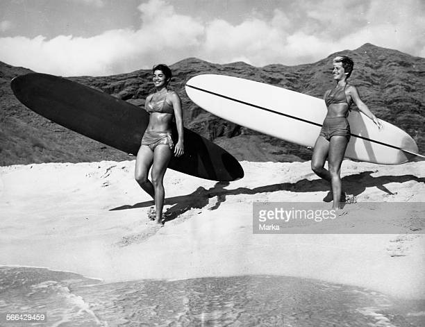 Young Women Holding Surfboard 1960