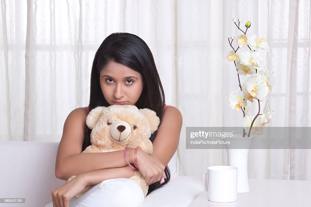 Young WOMEN hugging a stuffed toy : Stock Photo