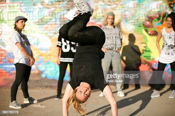 Young women in a breakdancing handstand freeze
