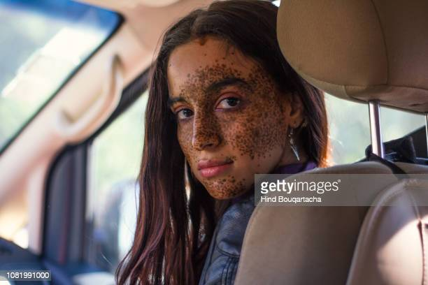 young women in a car - light skin black woman stock photos and pictures
