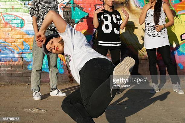Young women in breakdancing freeze