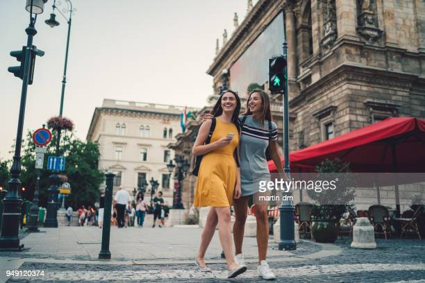young women in budapest crossing the street at the pedestrian walkway - hungary stock pictures, royalty-free photos & images