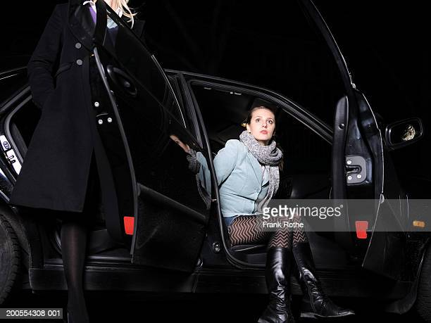 young women in car at night, low angle view - celebrity stockings stock pictures, royalty-free photos & images