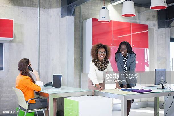 Young women in creative office