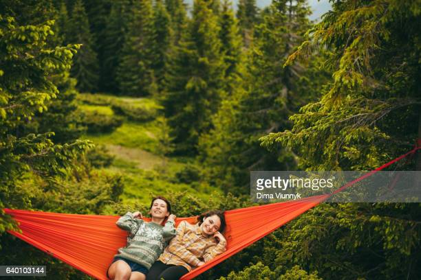 Young women in hammock in the mountains