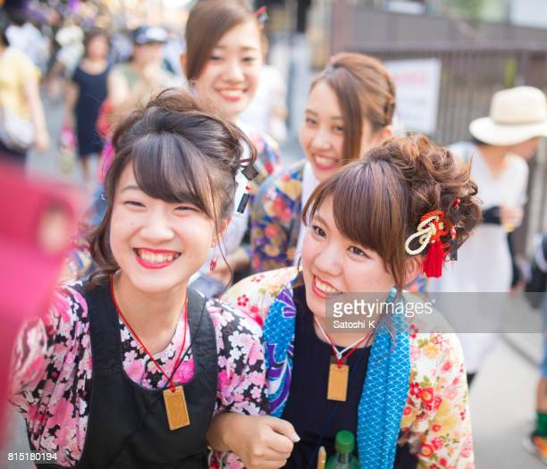 Young women in Japanese matsuri outfit taking selfie picture with full of smile