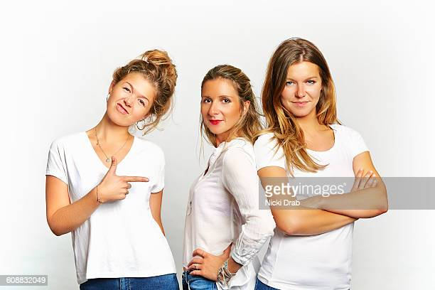 young women in jeans and tshirt striking pose - drei personen stock-fotos und bilder
