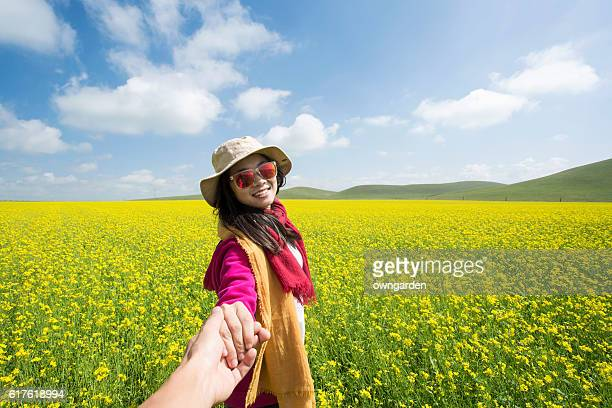 Young women in rapeseed field