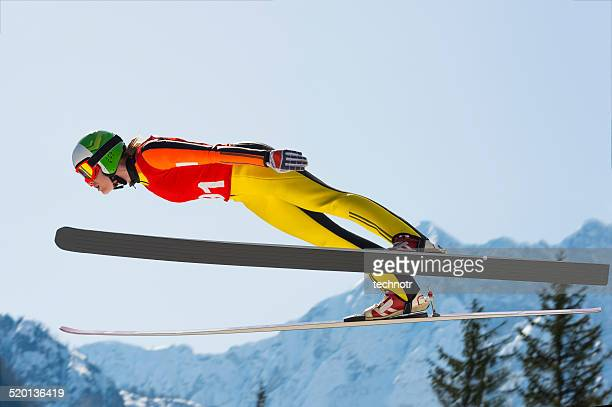 young women  in ski jumping action - ski jumping stock pictures, royalty-free photos & images