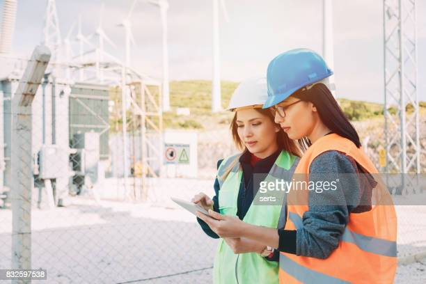 young women in stem - electrical component stock photos and pictures