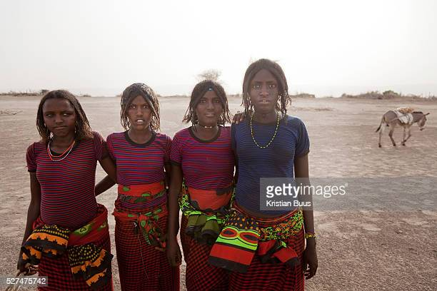 Young women in the desert on their way to Delafagi Delafagi is the biggest town in Afar and every Tuesday its market dayThe Afars speak their own...