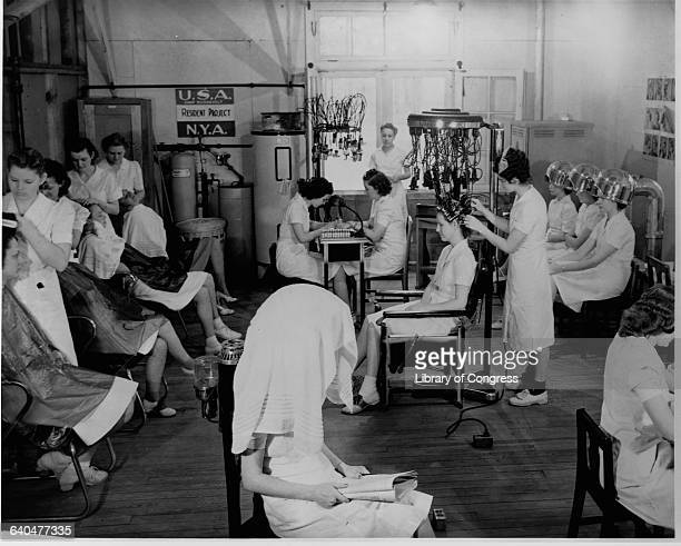 Young women in the National Youth Administration work in a beauty shop to learn beautician skills at Camp Roosevelt in Ocala