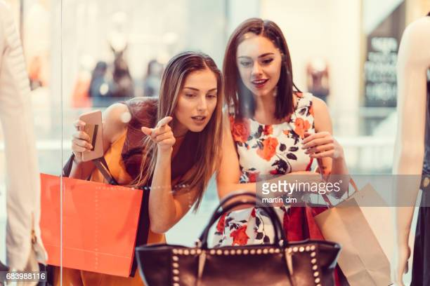 young women in the shopping mall - shopping mall stock pictures, royalty-free photos & images