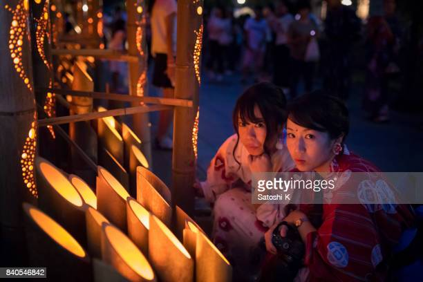 young women in yukata and bamboo candle lights in obon night event in japan - kanto region stock photos and pictures