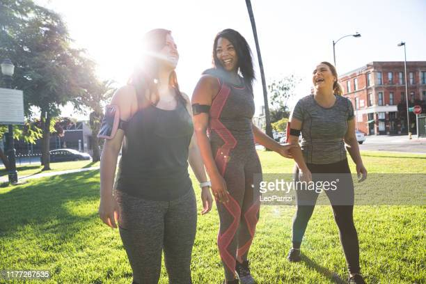 young women jogging and getting healthy at the park - body positive stock pictures, royalty-free photos & images