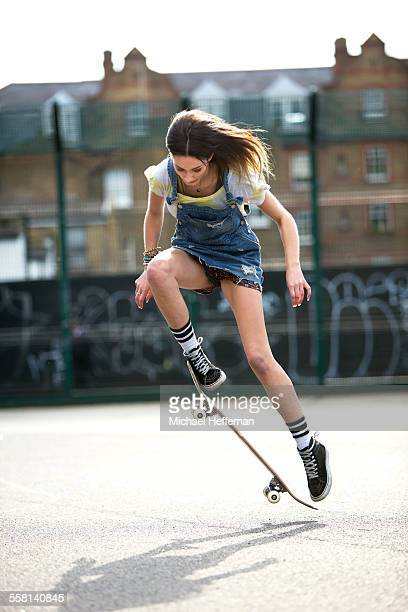 Young women jumping with skateboard