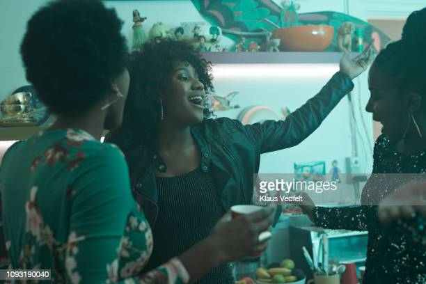 young women laughing and having party in the kitchen - party stock pictures, royalty-free photos & images