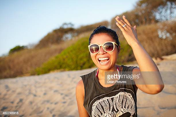 Young women laughing on beach, Costa Rica