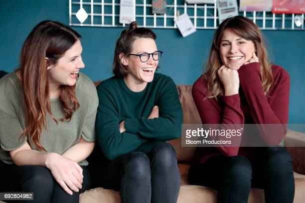 young women laughing together - three people stock pictures, royalty-free photos & images
