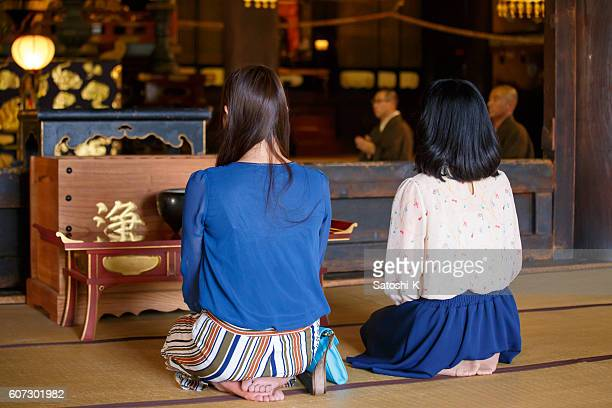 Young women listening to sutra in temple