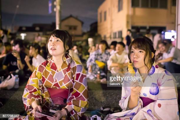 Young women looking at fireworks show