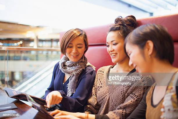 Young women looking at magazine
