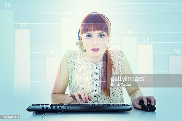 Young women looking stock market data on the scree