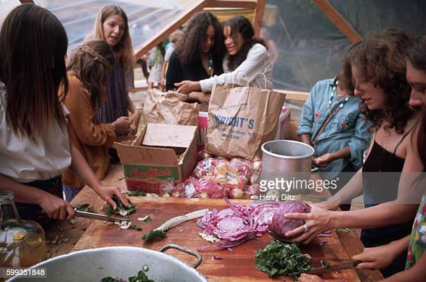 Young women make salad in the tent kitchen of commune called 'Hog Farm' in Woodstock New York