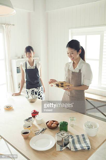 Young women making cookie
