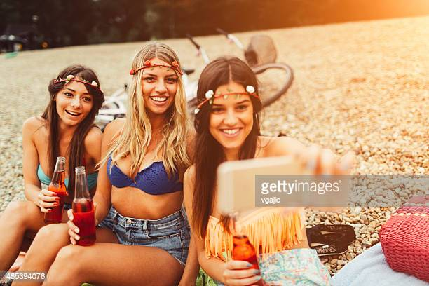 Young women making selfie on the beach.