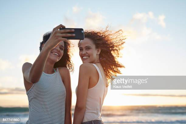 Young women making selfie on the beach