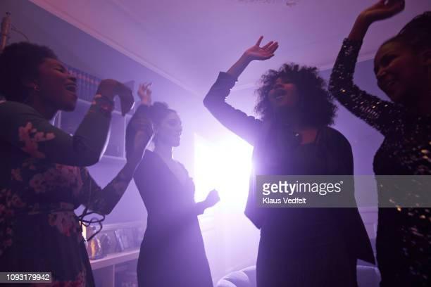 young women making selfie while dancing - fête photos et images de collection