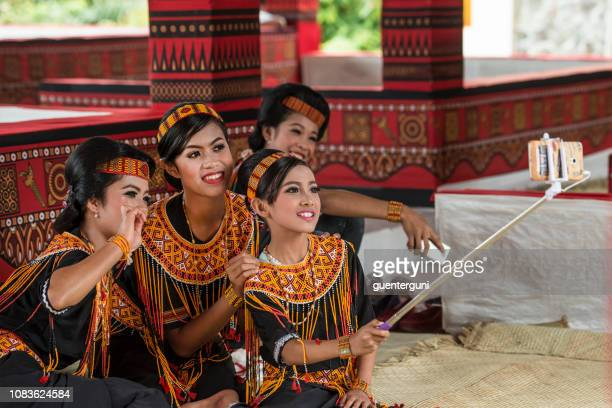 Young women of the Toraja tribe in traditonal clothing, Sulawesi