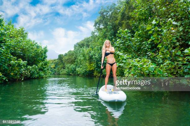 young women on a paddle board - kauai stock photos and pictures
