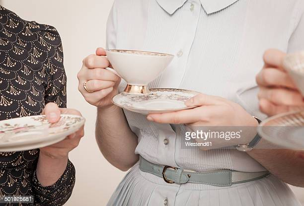 young women on a retro style tea party, close-up - tea party stock pictures, royalty-free photos & images