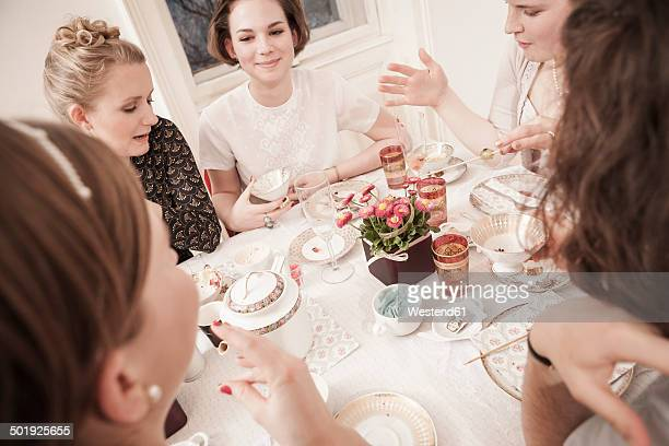 Young women on a retro style tea party