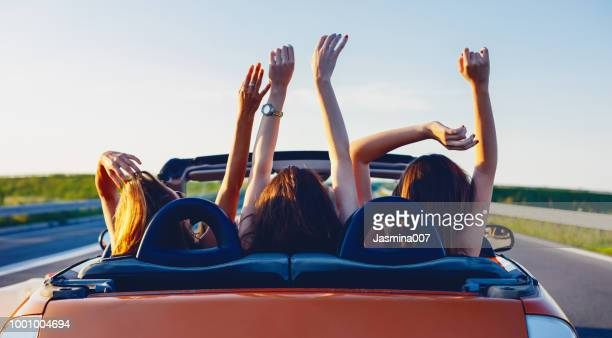 young women on a road trip with cabriolet - convertible stock pictures, royalty-free photos & images