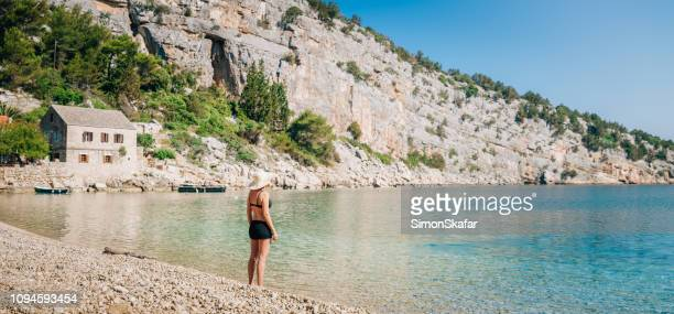 young women on beach - hvar stock photos and pictures