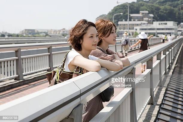 Young women on bridge