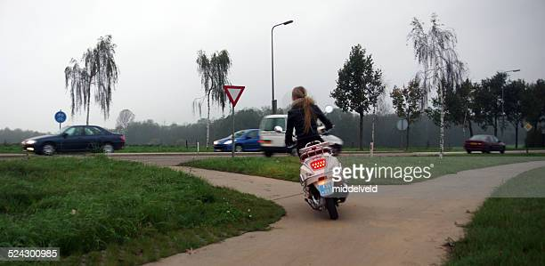 young women on here scooter - moped stock photos and pictures