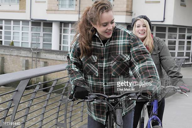 2 young women on push bikes